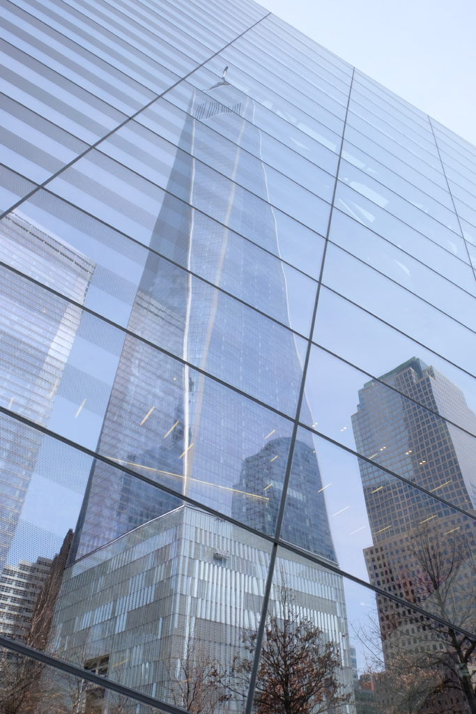 9/11 Museum reflecting the one world trade center