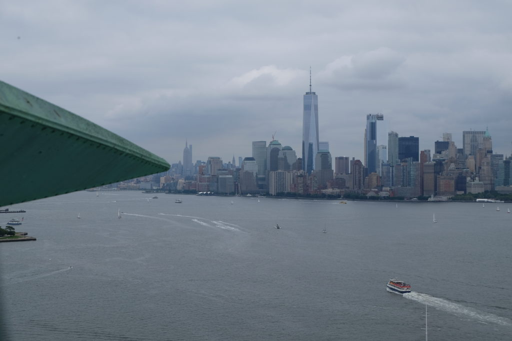 The crown pointing at Manhattan